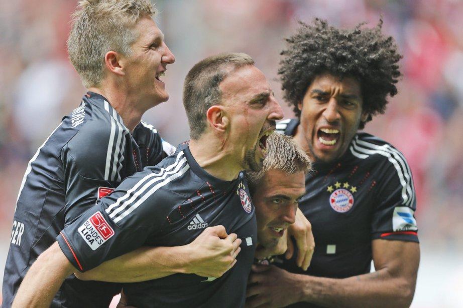 Franck Ribéry (au centre) du Bayern Munich a... (Photo Frank Augstein, Associated Press)