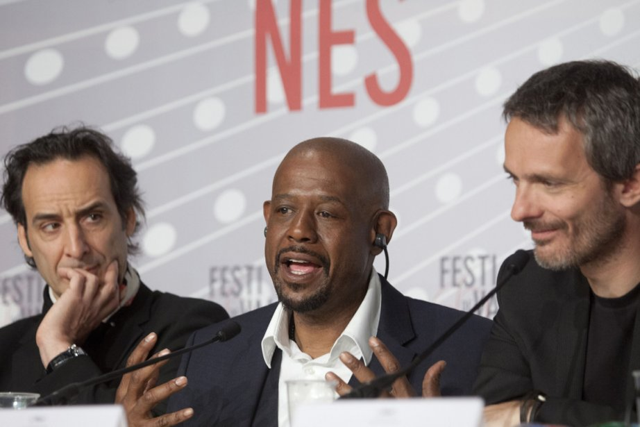 L'acteur Forest Whitaker, entouré du compositeur Alexandre Desplat... (Photo : Virginia Mayo, AP)