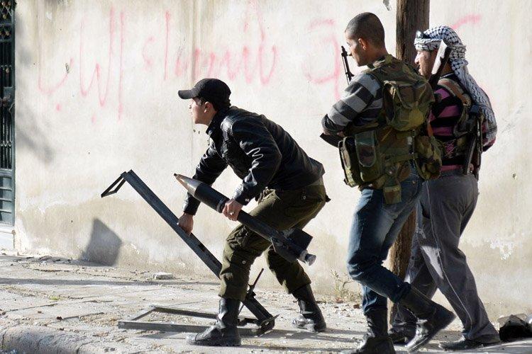 Les États-Unis, qui refusent de livrer des armes aux rebelles... (Photo: AFP)
