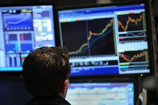 La Bourse de Toronto a clôturé en hausse jeudi, stimulée... (PHOTO ARCHIVES AFP)