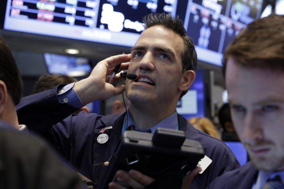 Wall Street a terminé en légère hausse jeudi,... (Photo Richard Drew, AP)