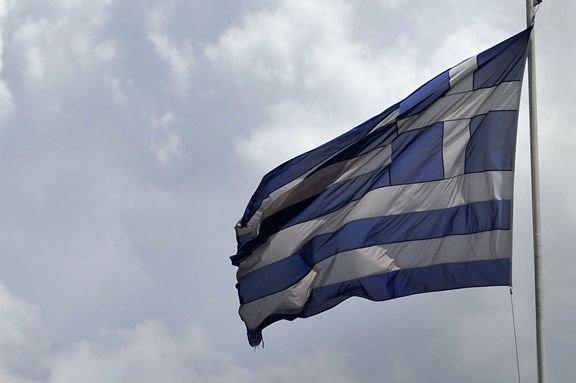 Le drapeau de la Grèce.... (PHOTO LOUISA GOULIAMAKI, AFP)