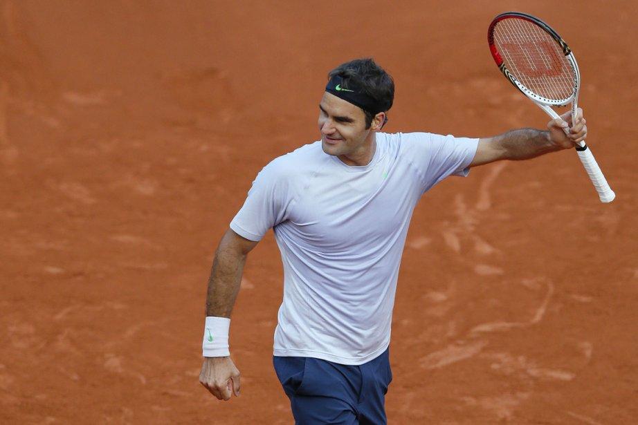 Malgré une cheville tordue, Federeraccède aux quarts de... (PHOTO PATRICK KOVARIK, AFP)
