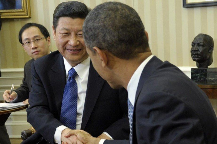 Les deux présidents Barack Obama et Xi Jinping... (PHOTO Susan Walsh, AP)