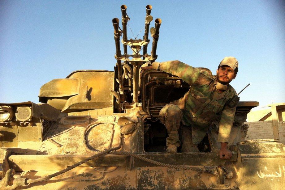 Le régime syrien a reconnu pour la première... (PHOTO AFP)