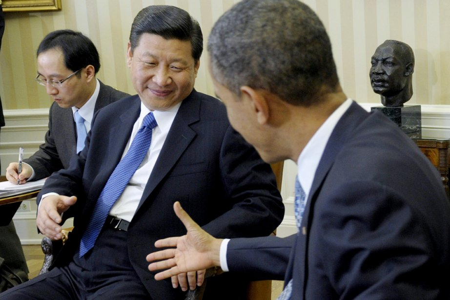 Barack Obama (à droite) et Xi Jinping, qui... (PHOTO SUSAN WALSH, ARCHIVES AP)