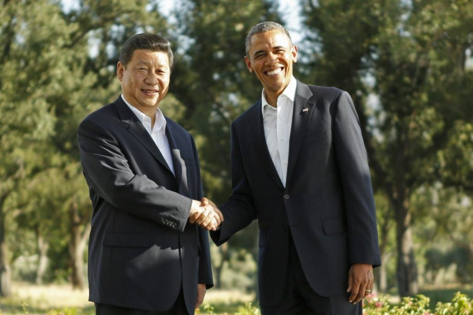 Barack Obama et son homologue Xi Jinping. Le... (PHOTO KEVIN LAMARQUE, AFP)