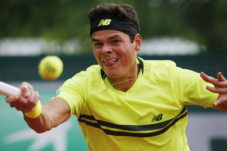 Milos Raonic... (Photo Christophe Ena, AP)
