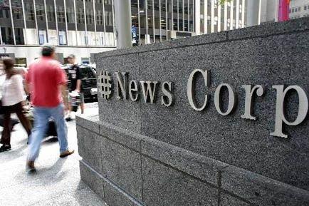 News Corp avait annoncé en milieu d'année dernière... (Photo Archives AP)