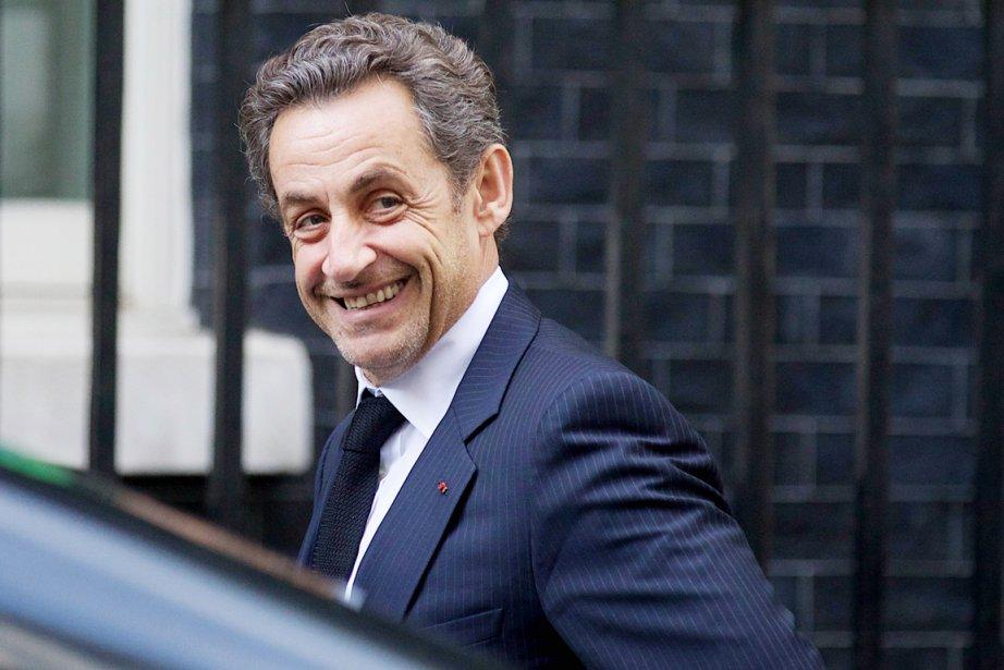 L'ex-président français Nicolas Sarkozy était tout sourire à... (Photo Andrew Cowie, archives Agence France-Presse)