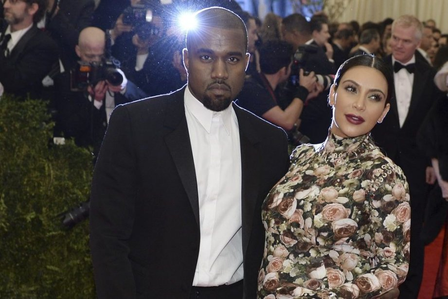 Kanye West et Kim Kardashian... (PHOTO TIMOTHY A. CLARY, AFP)