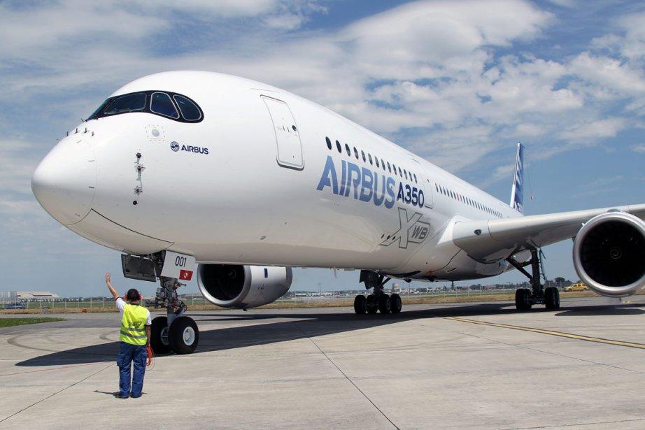 Le vol réussi de l'A350 vendredi à Toulouse,... (Photo : Bob Edme, AP)