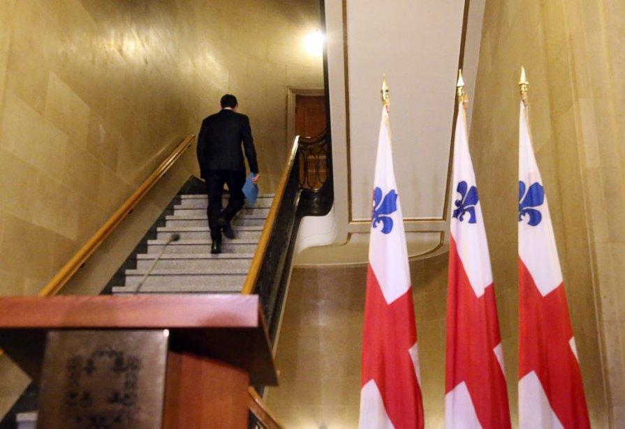 Michael Applebaum quitte les lieux après avoir annoncé... (Photo CHRISTINNE MUSCHI, Reuters)