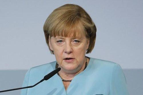 «Je partage l'avis du ministre (allemand) des Affaires... (Photo Tobias Schwarz, AP)