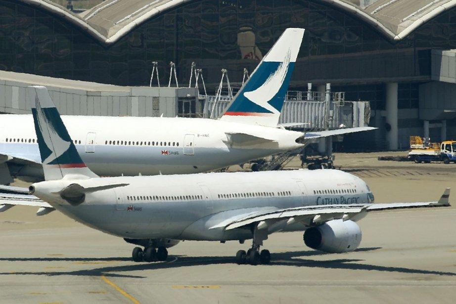 Des avions de la compagnie Cathay Pacific.... (Photo Archives AFP)