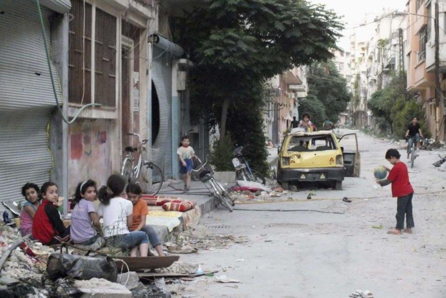 Des enfants dans les rues de Homs en... (Photo AP)
