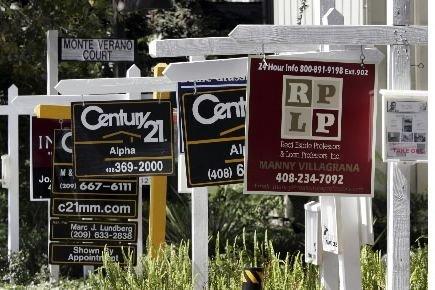 Les prix des logements ont augmenté en avril aux... (Photo Associated Press)