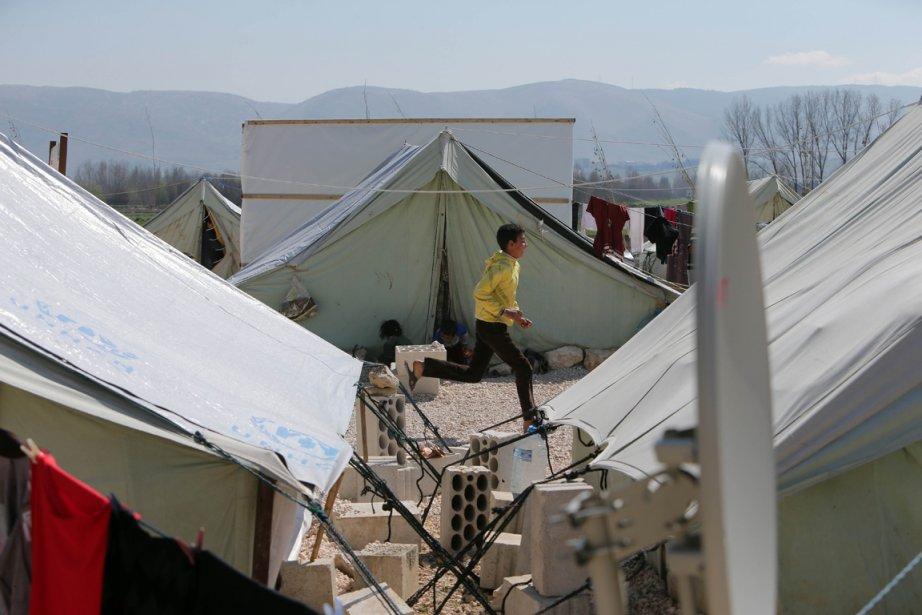Un camp de réfugiés syriens munis de tentes... (Photo Joseph Eid, AFP)