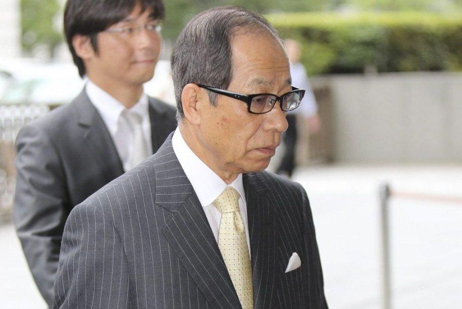 Tsuyoshi Kikukawa et ses deux acolytes ont été... (PHOTO AFP/JIJI PRESS)