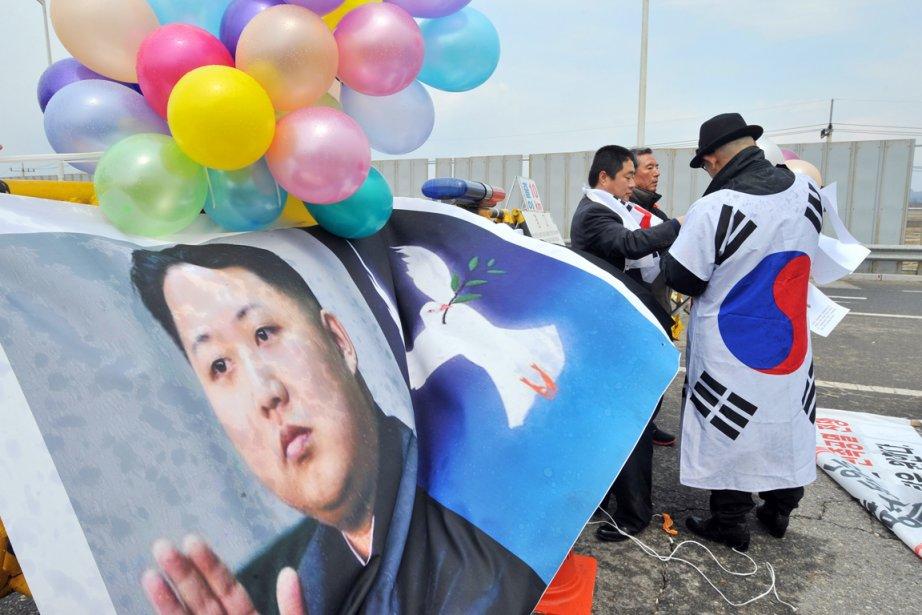 Des pacifistes sud-coréens manifestent dans la ville frontalière... (PHOTO JUNG YEON-JE, ARCHIVES AFP)