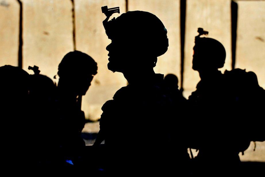Actuellement, la moitié des 68000 soldats américains en... (PHOTO MANJUNATH KIRAN, ARCHIVES AFP)