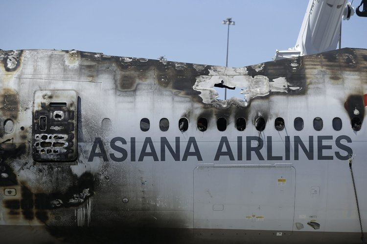 Un groupe de 83 passagers du vol 214 d'Asiana Airlines accidenté à... (Photo: AP)