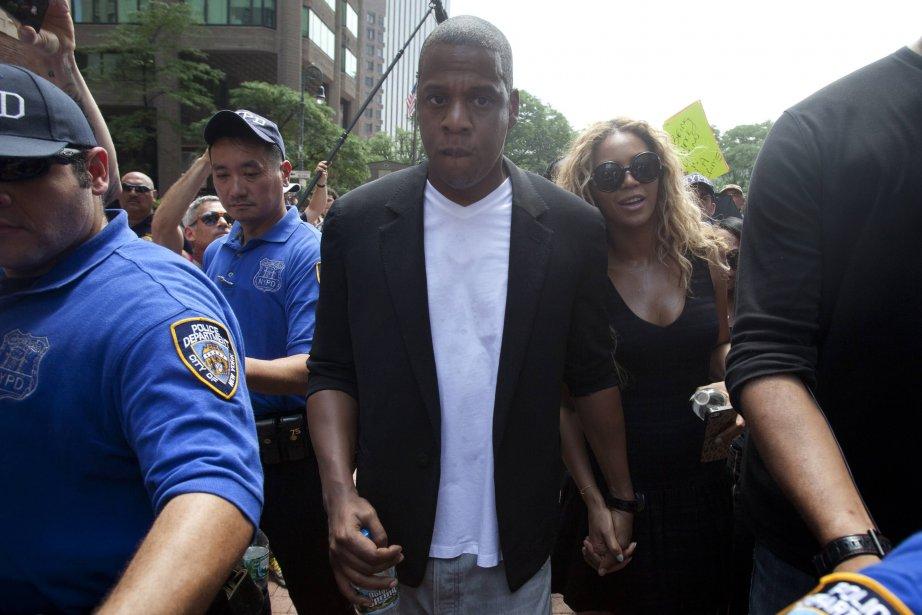 Jay Z en compagnie de son épouse Beyonce.... (Photo Carlo Allegri, Reuters)