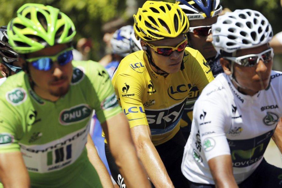 Peter Sagan(maillot vert du meilleur sprinteur),Christopher Froome (maillot... (PHOTO JEFF PACHOUD, AFP)