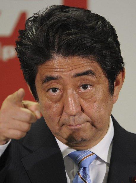 Le premier ministre Shinzo Abe lors d'une conférence... (Photo AFP)