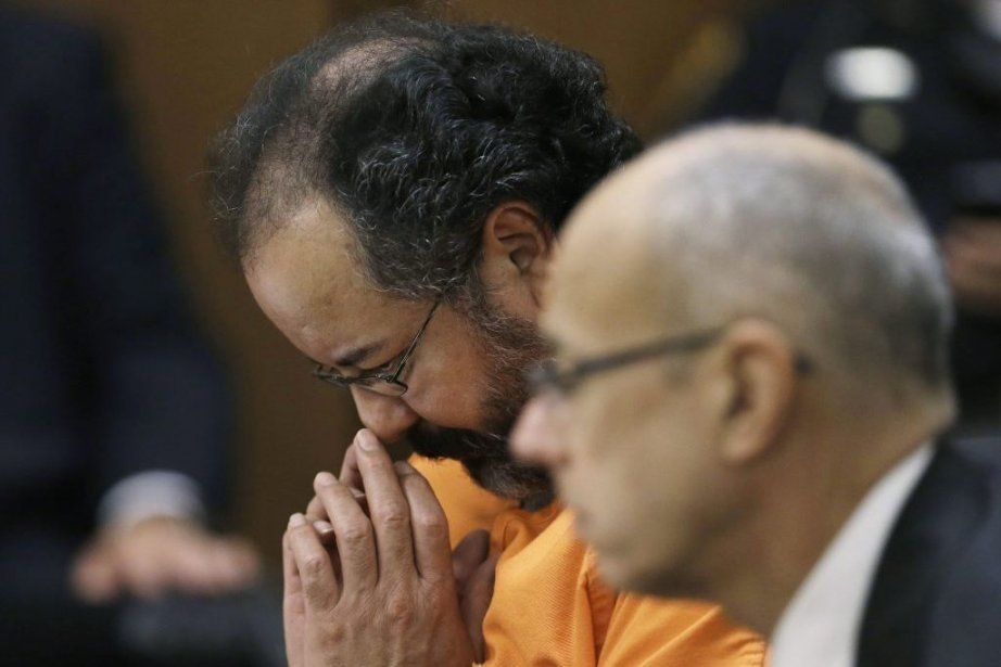 Ariel Castro (gauche) lors de son procès, accompagné... (Photo AP)