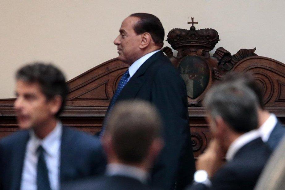 Berlusconia été condamnéà une peine de prison confirmée... (Photo AFP)