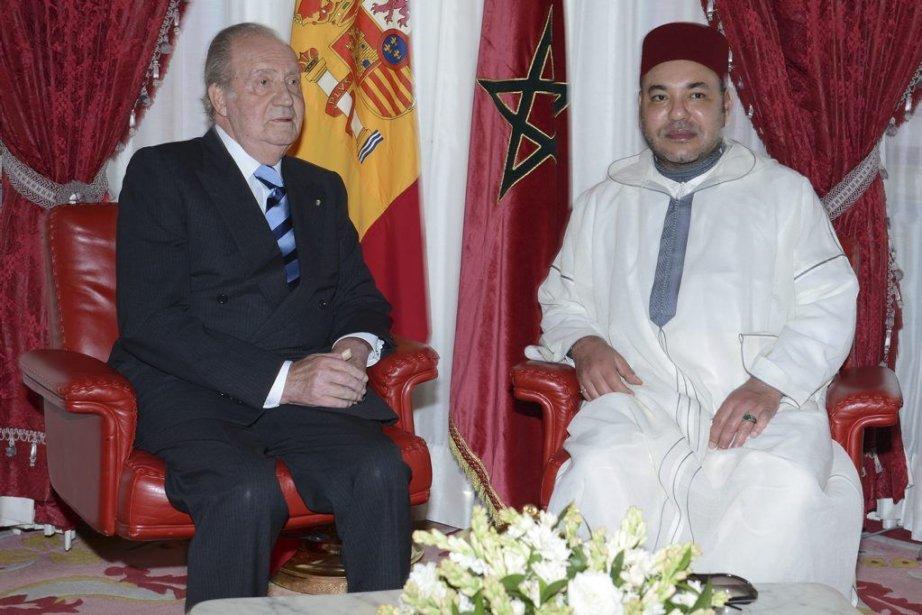 Le roi d'Espagne Juan Carlos et son homologue... (Photo Associated Press)