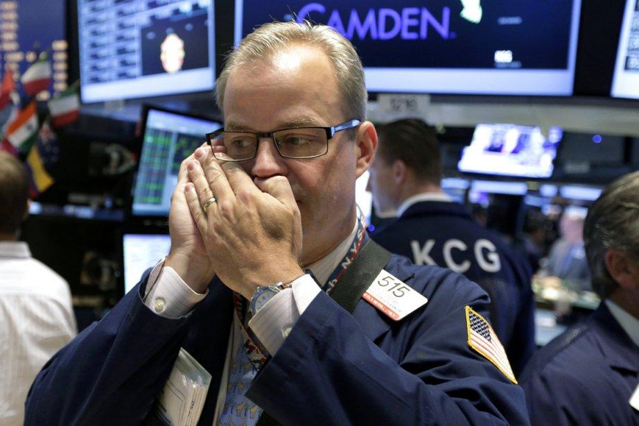 Wall Street avait grimpé à de nouveaux sommets... (PHOTO RICHARD DREW, AP)