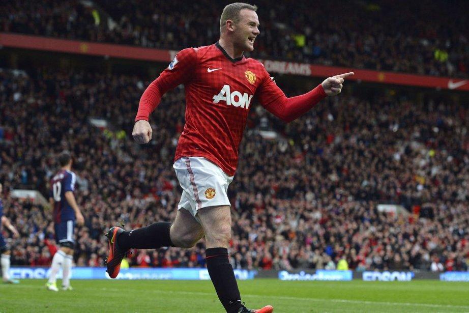 Wayne Rooney... (PHOTO NIGEL RODDIS, REUTERS)