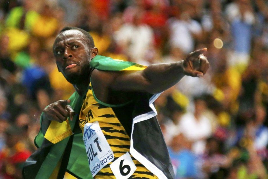 Usain Bolt... (PHOTO KAI PFAFFENBACH, REUTERS)