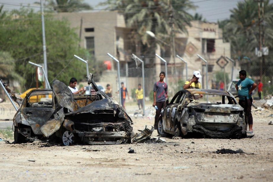 Une voiture a explosé à Baladiyat, près de... (Photo Ali Al-Saadi, Agence France-Presse)