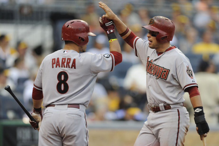 Gerardo Parra félicite son coéquipierMartin Prado après qu'il... (Photo David DeNoma, Reuters)