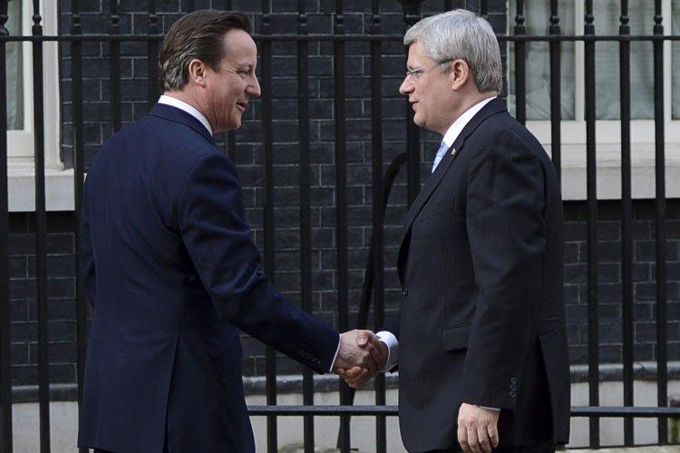 Le premier ministre britannique David Cameron a accueilli... (Photo: PC)