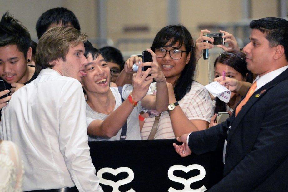 Les vidéos de gamer de PewDiePie suscitent l'enthousiasme... (PHOTO ROSLAN RAHMAN, AFP)