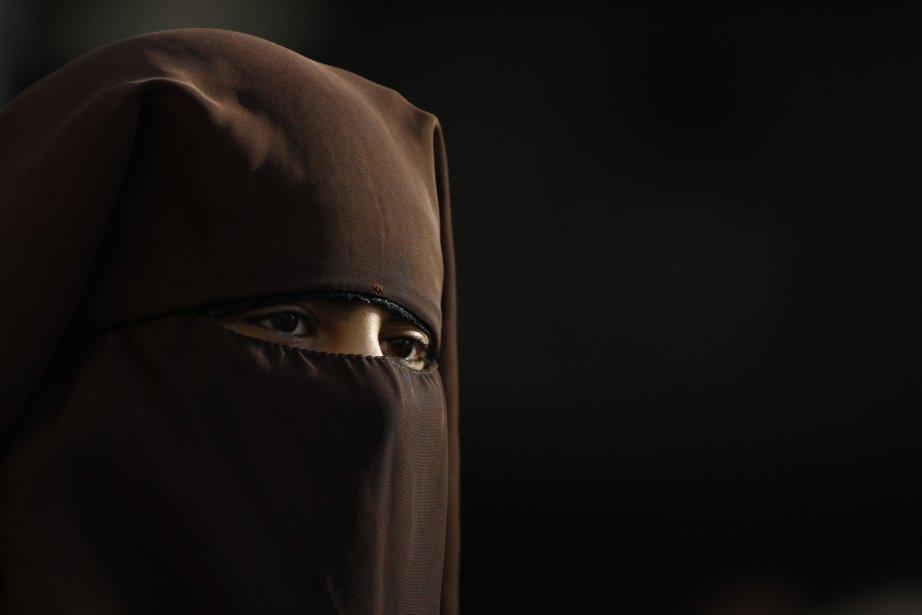 En vertu de la proposition gouvernementale, le hijab,... (Photo Michael Buholzer, Reuters)