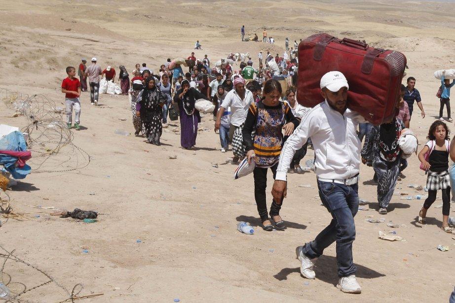 La semaine dernière, plus de 30 000 Kurdes... (PHOTO Thaier al-Sudani, REUTERS)