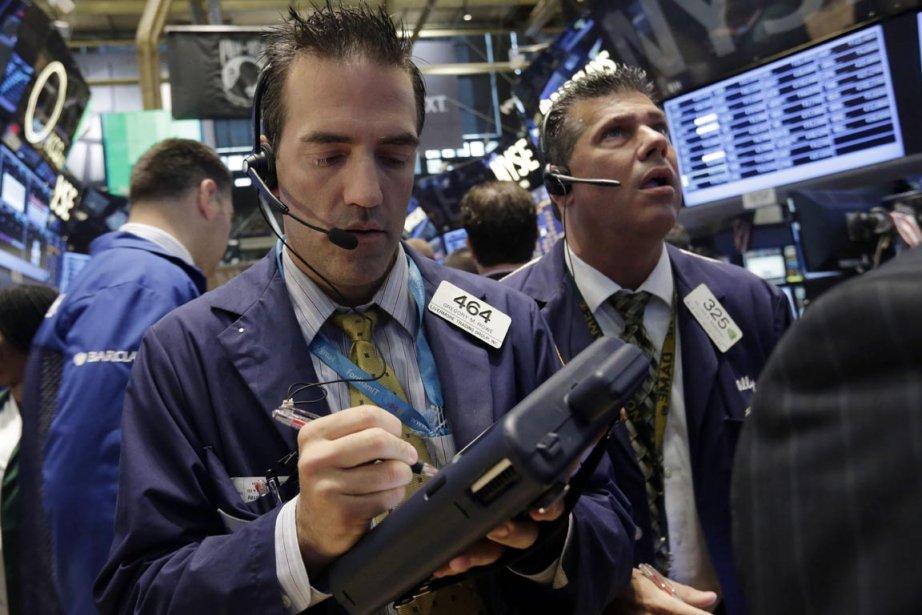 Wall Street a fini sur une note contrastée mercredi,... (Photo Richard Drew, AP)