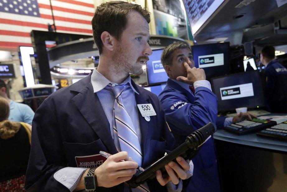 Wall Street avait terminé dans le vert jeudi.... (Photo Richard Drew, AP)