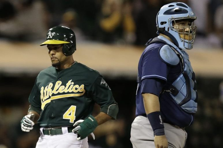 Coco Crisp a produit deux points.... (Photo Ben Margot, AP)
