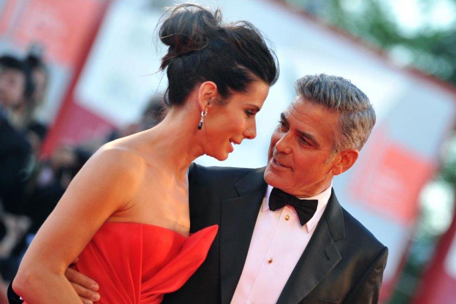 Sandra Bullock et George Clooney avant la projection du film «Gravity». Le thriller de l'espace du Mexicain Alfonso Cuaron a donné le coup d'envoi mercredi soir de la 70e Mostra de Venise, le plus vieux festival de cinéma du monde. | 3 septembre 2013