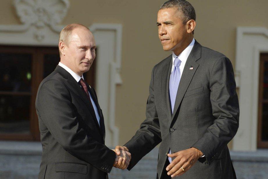 Le président russe Vladimir Poutine a accueilli d'une... (PHOTO ERIC FEFERBERG, AFP)