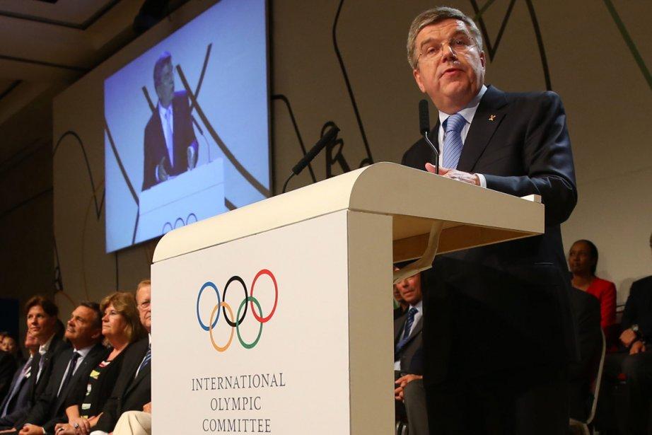 Le nouveau président du Comité international olympique (CIO),... (Photo Alexander Hassenstein, AP)