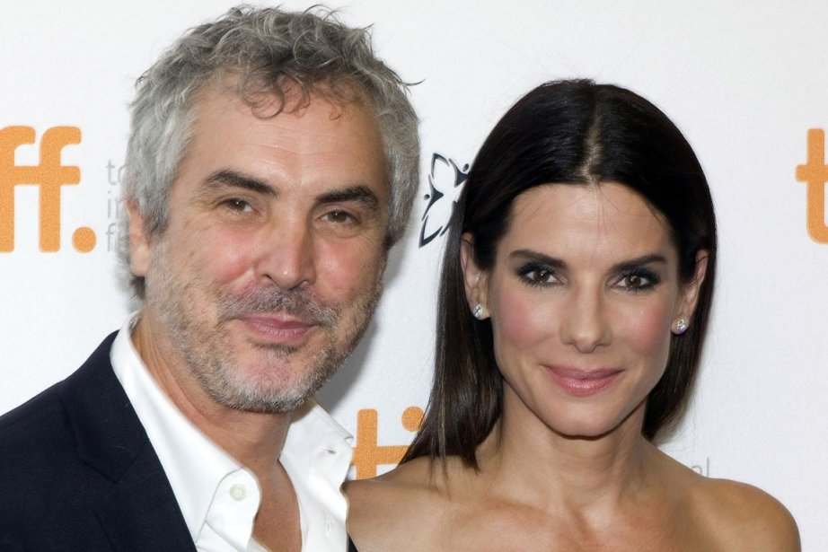 Alfonso Cuarón et Sandra Bullock... (PHOTO FRED THORNHILL, REUTERS)