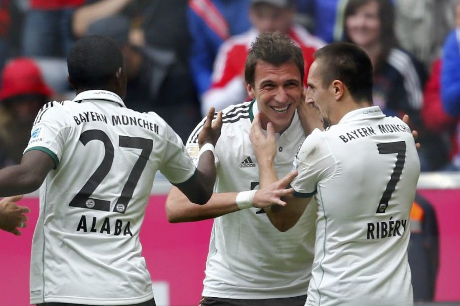 David Alaba (27), Franck Ribery (7) et Mario... (PHOTO MICHAEL DALDER, REUTERS)