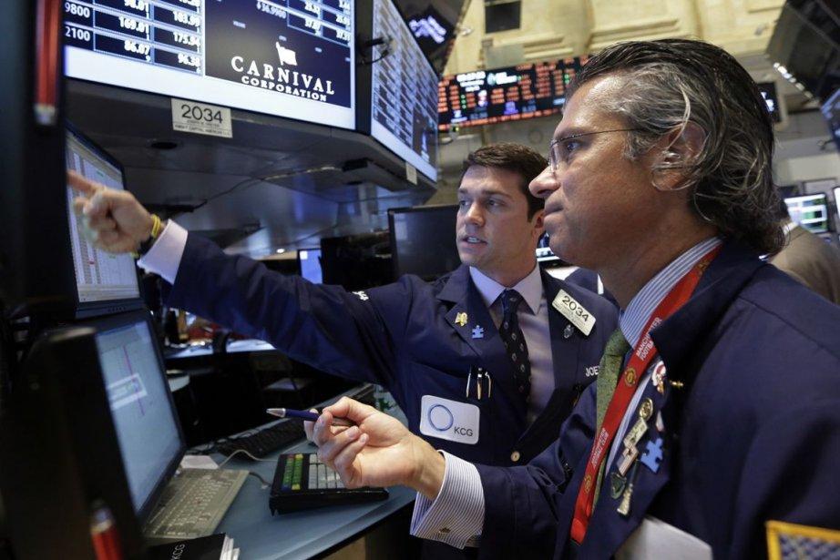 Wall Street a poursuivi sa course aux records... (PHOTO RICHARD DREW, AP)